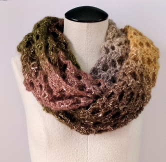 This infinity scarf is made using Lion Brand Shawl in a Ball and Moogly's Opal Arrows pattern.